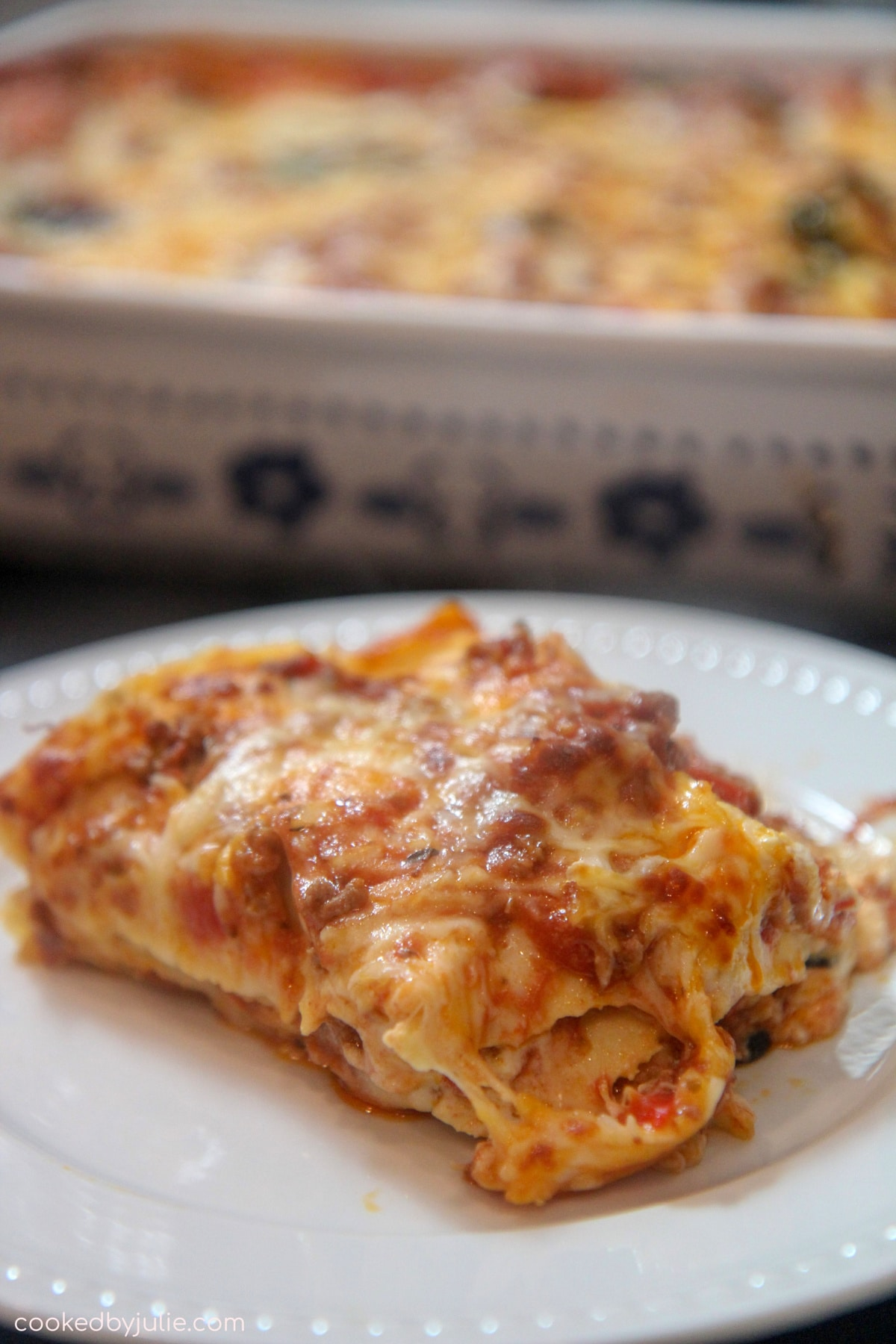 a serving of lasagna on a plate