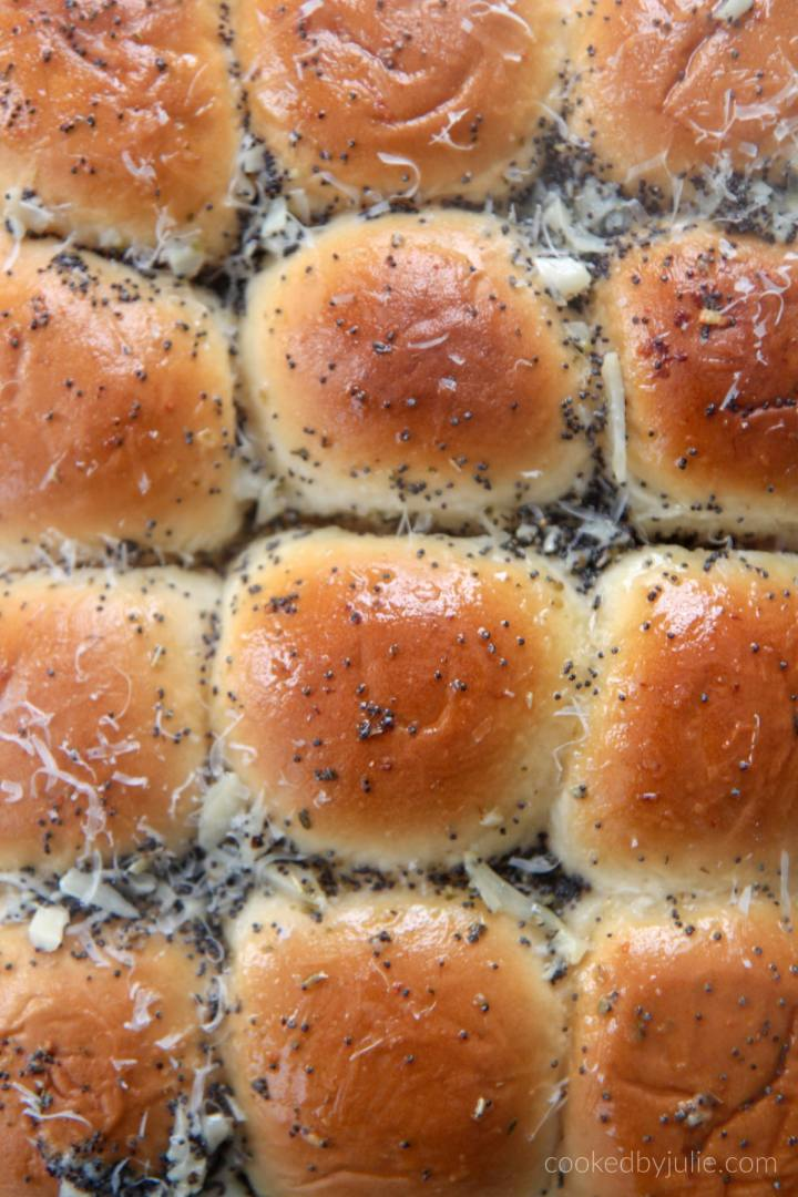Hawaiian soft rolls brushed with a butter and poppy seed mixture