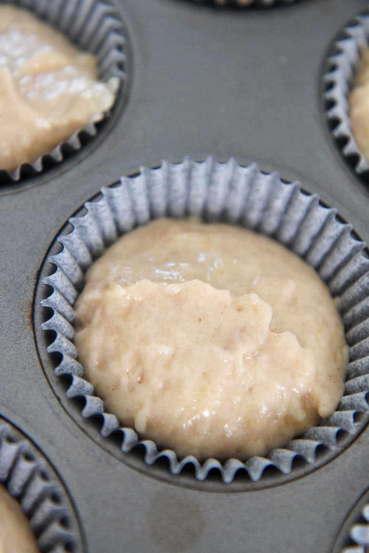 banana muffin batter in a cupcake liner