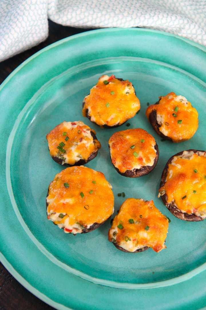six cheese stuffed mushrooms on a blue plate