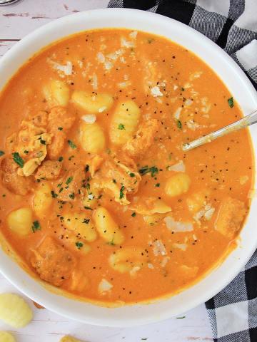 instant pot tomato gnocchi soup in a white bowl