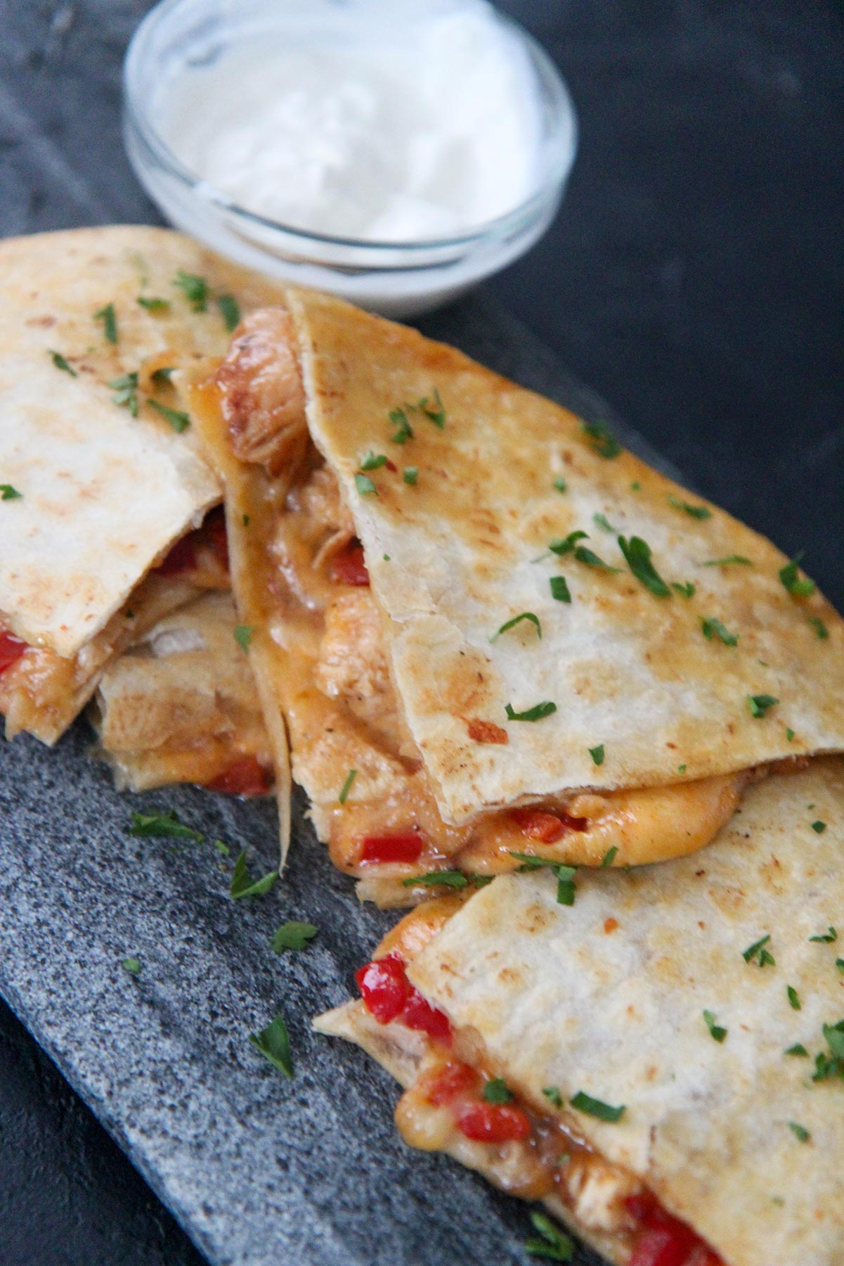cheese and chicken quesadillas with sour cream on the side