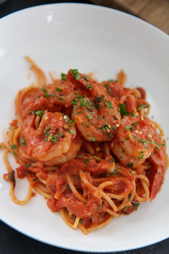 white bowl with seafood pasta up close