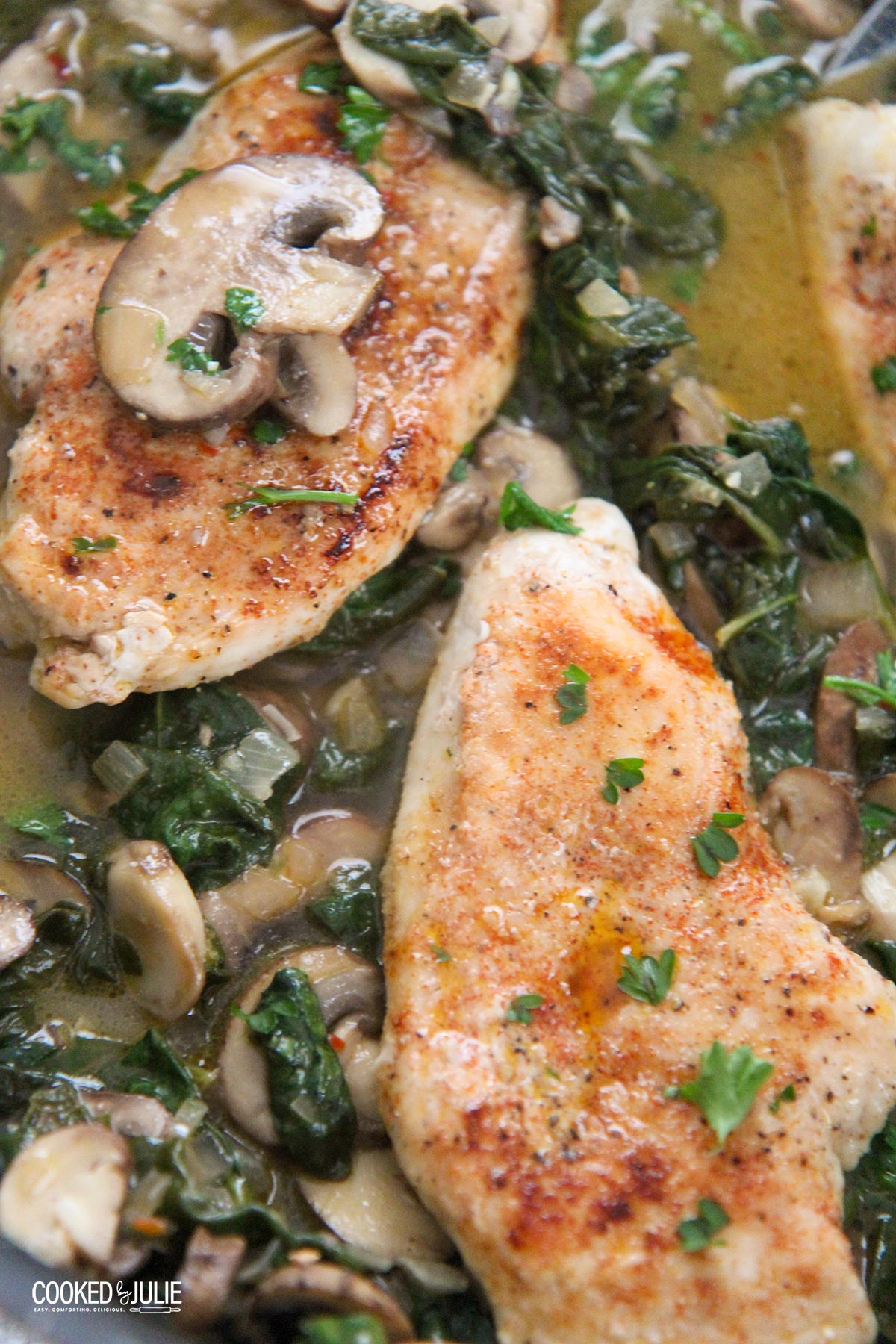 chicken, spinach, and mushroom in a skillet