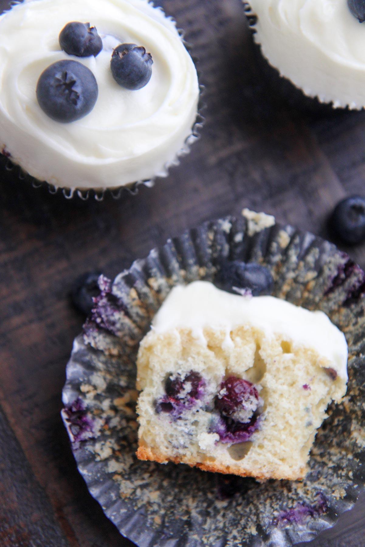 half eaten blueberry cupcake up close