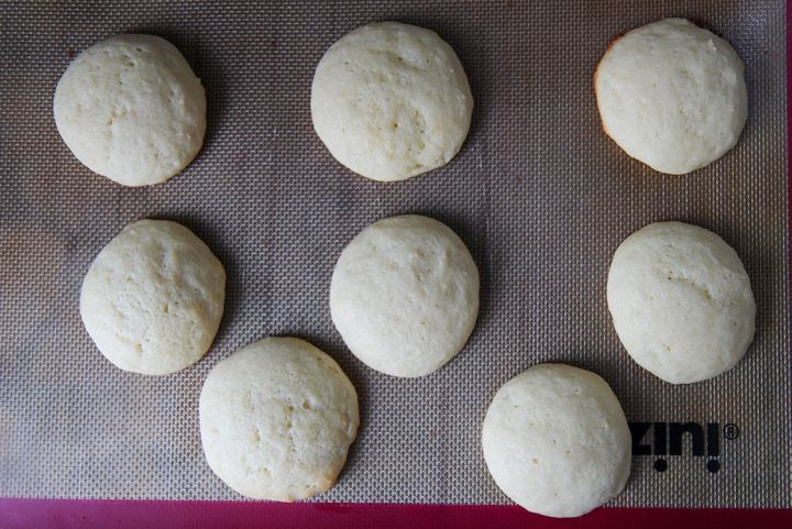 eight soft baked cookies on a baking sheet.