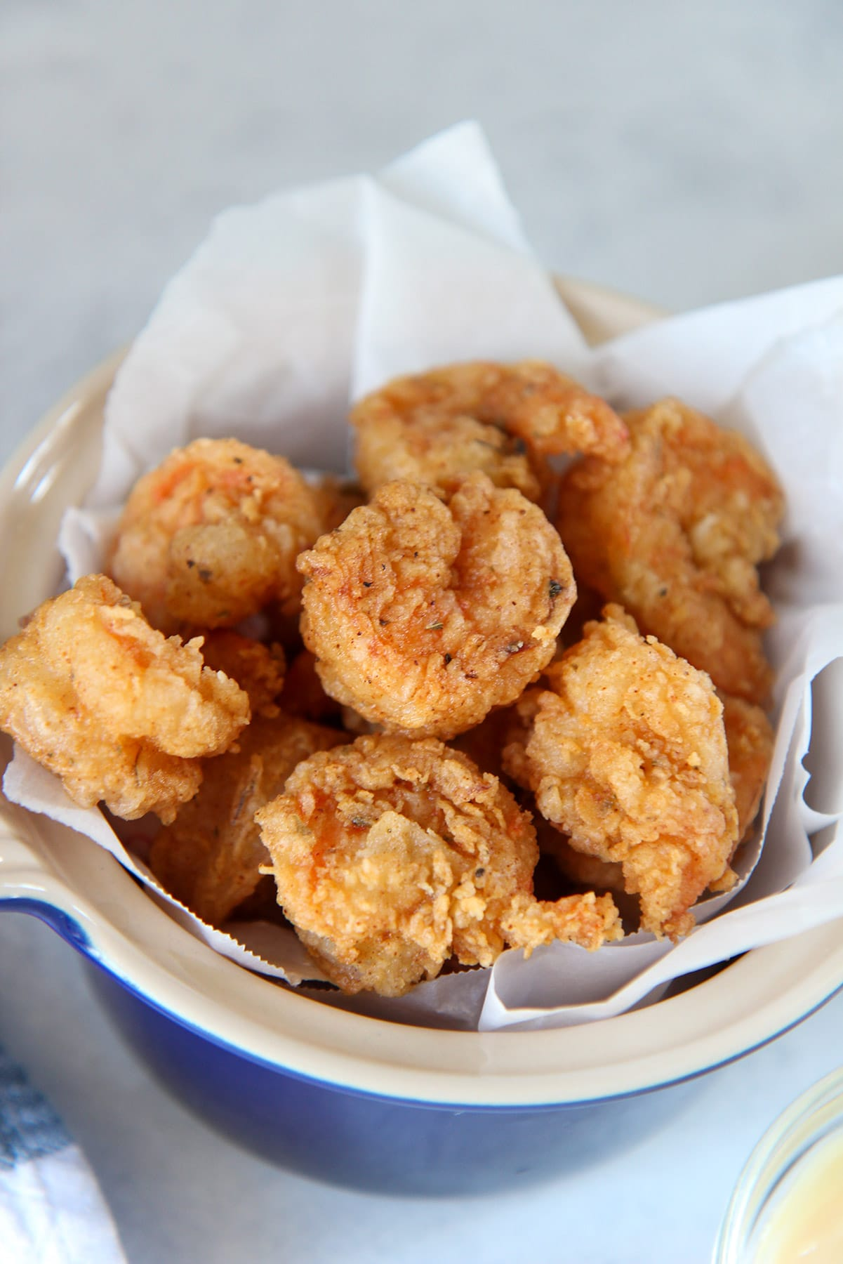 fried shrimp in a blue small bowl