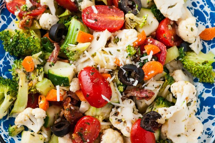 vegetable salad with homemade Italian dressing up close.