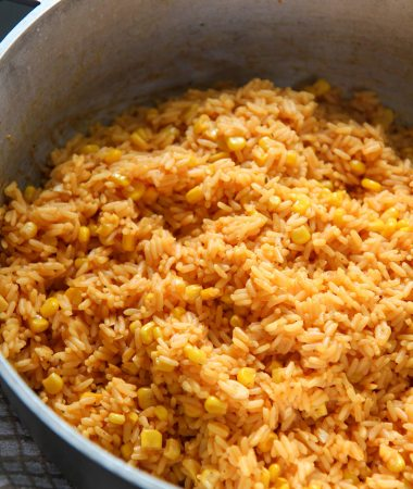 yellow rice with corn in a big pot.
