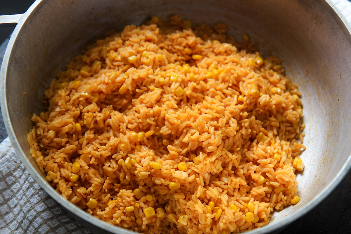 a horizontal photo of yellow rice in a pot.