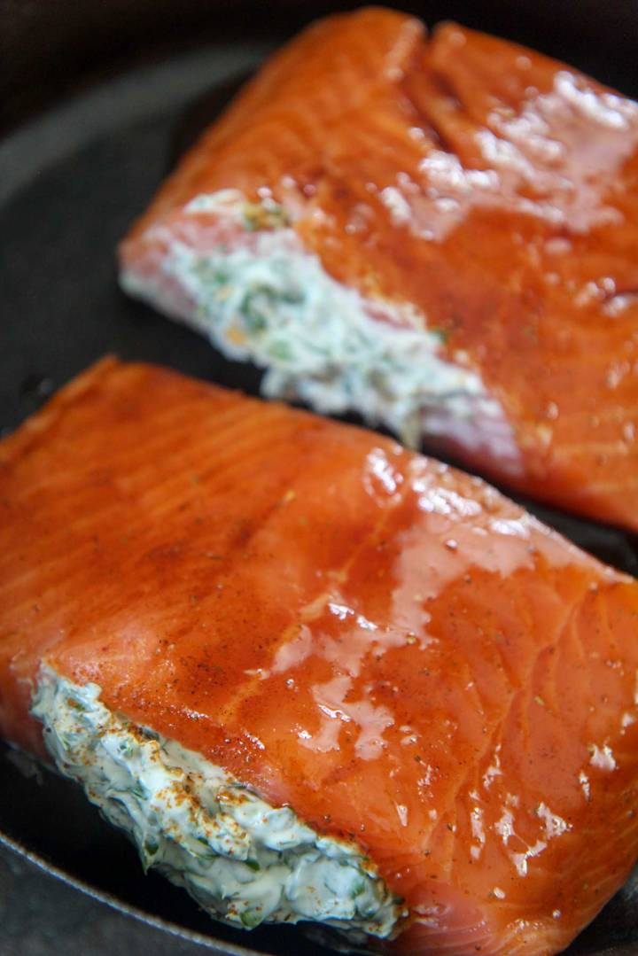 raw salmon filled with spinach and cream cheese.