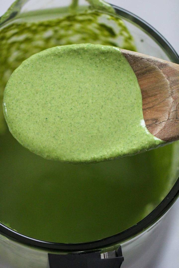 green sauce on a wooden spoon.