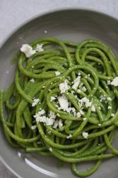 tallarines verdes on a plate up close.