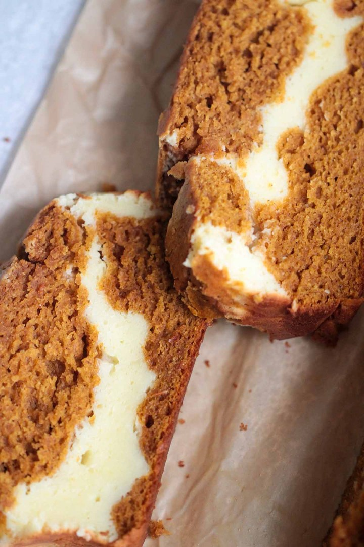 two slices of cream cheese pumpkin bread.