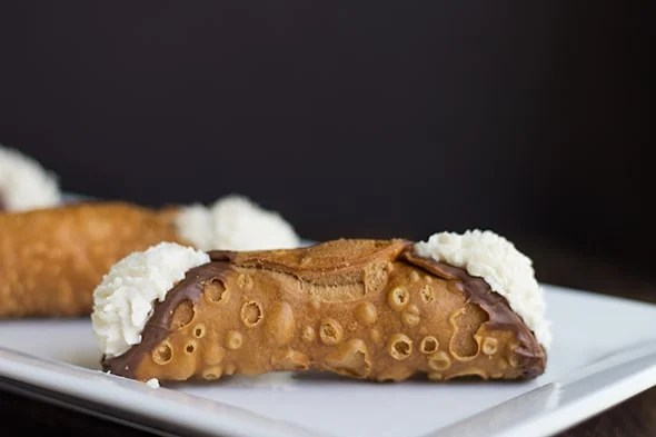 a plate of homemade cannoli