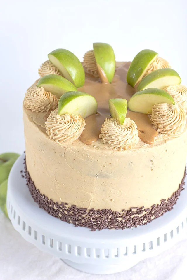 Apple Cake with Peanut Butter Frosting on a white cake stand