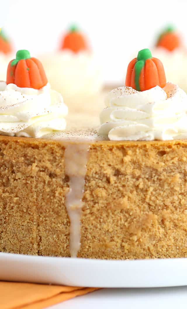Pumpkin Cheesecake - Thick, creamy cheesecake stuffed full of all the right spices for a pumpkin pie! To finish the pumpkin cheesecake off, I added a maple white chocolate ganache, whipped cream, a dusting of cinnamon, and cute little candy pumpkins! This would be a hit for Thanksgiving dessert!