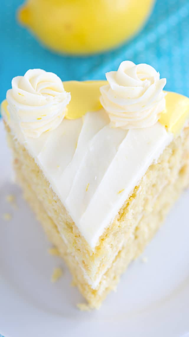 overhead photo - slice of lemon olive oil cake with cream cheese frosting