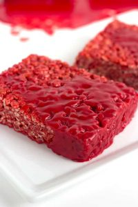 close up of bloody red velvet rice krispie treat on a white plate