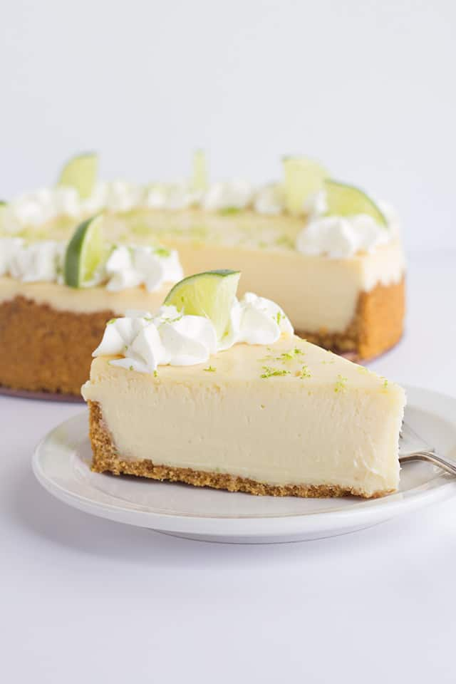 slice of key lime cheesecake on a white plate