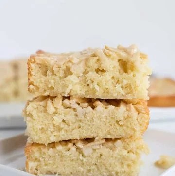 Squares of swedish visiting cake bars stacked on a small square plate