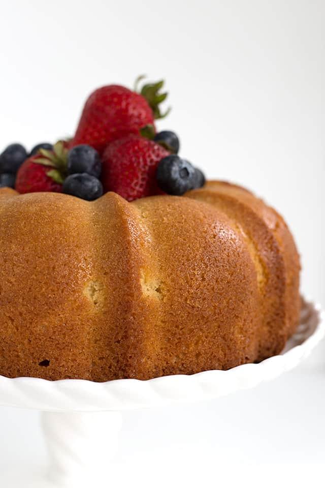 whole vanilla pound cake on white cake plate