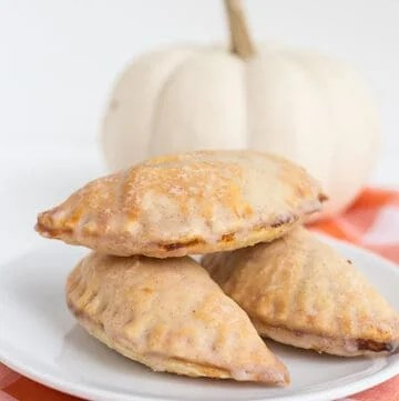 pumpkin pasties stacked on white plate