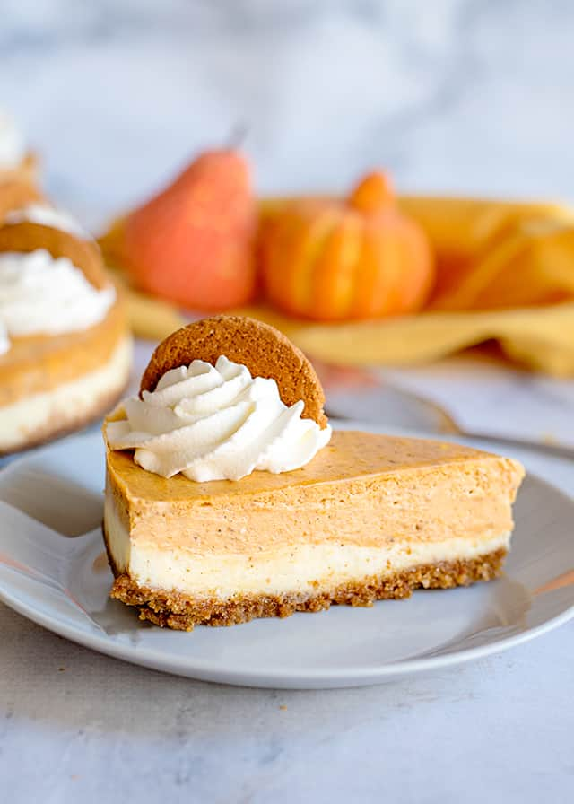 slice of double layer pumpkin cheesecake on white plate