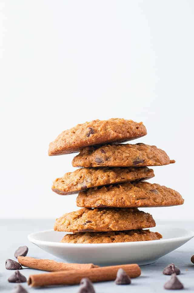 a staggered stack of pumpkin oatmeal chocolate chip cookies