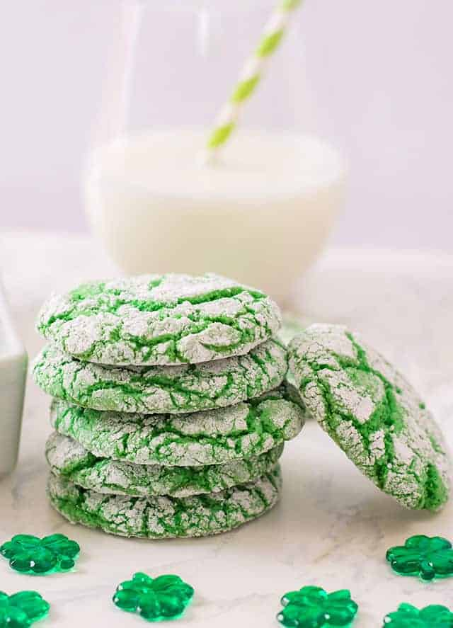 A stack of St. Patrick's Day Cookies with a glass of milk