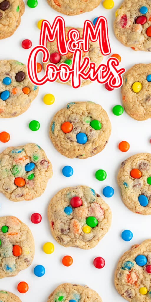 zoomed in overhead photo of cookies on a white background with candies scattered and text at the top