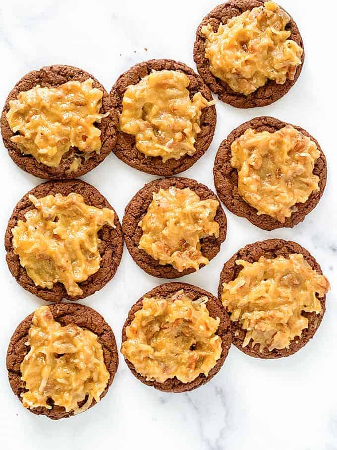 overhead photo of german chocolate cookies on a marble background
