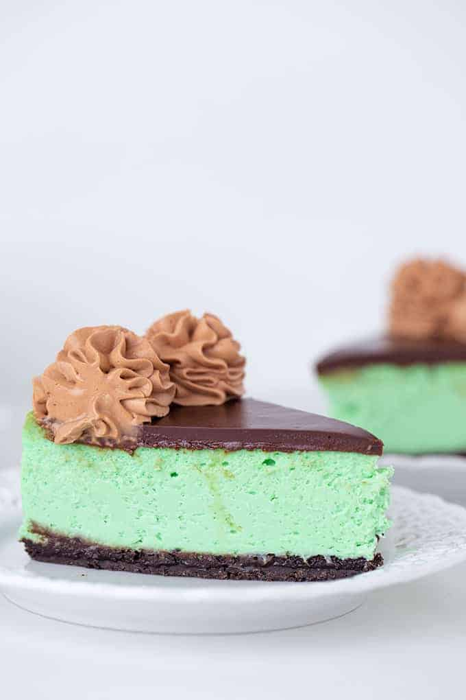 slice of green cheesecake on a white plate