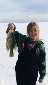 Young girl posing with her crappie