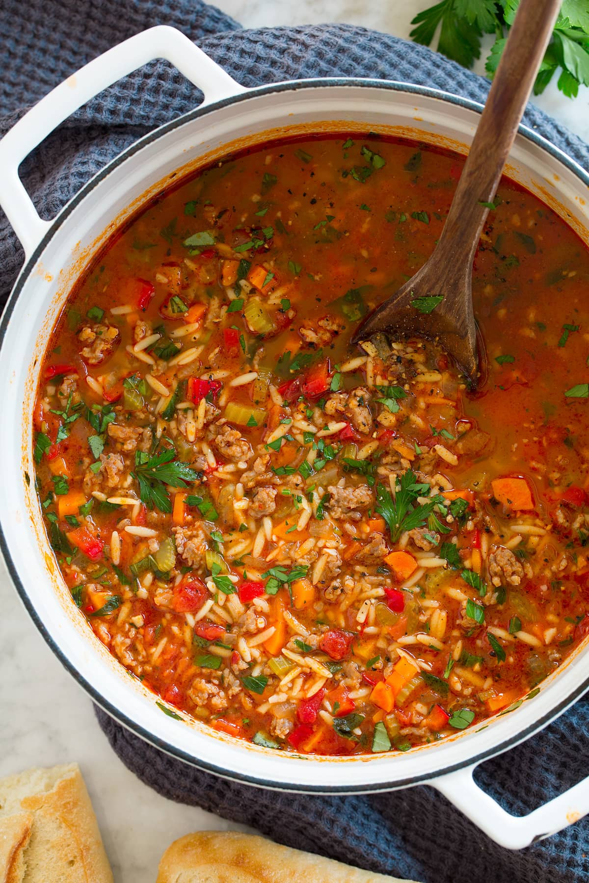 Overhead picture of Italian sausage soup in a saucepan.