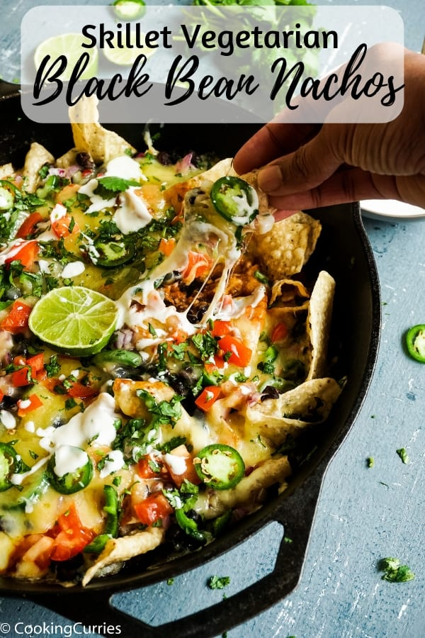 Deliciously crunchy, with layers of goodness and cheese, these vegetarian black bean nachos are so good that you wont miss the meat, and will want it over and over again for any game day gatherings or just any day! #superbowl #gameday #nachos #vegetarian