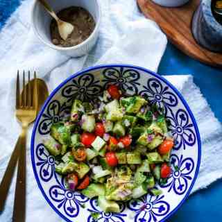 Chopped Cucumber, Avocado, Cherry Tomatoes and Onions as a salad in a bowl