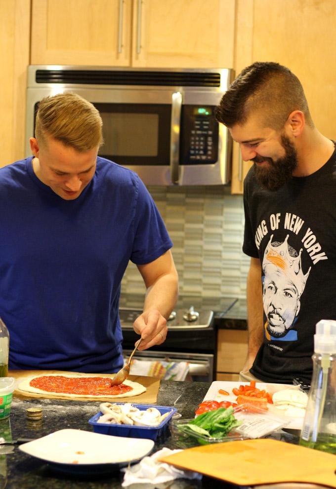 Ryan and Ryan making pizza