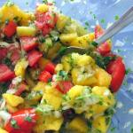 mango salsa with tomato, lime and coriander