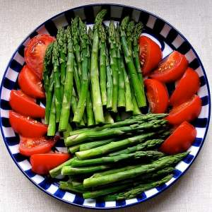 asparagus and tomato on plate