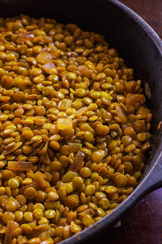 This curry braised lentils absorbs all the spices to make them creamy and tender. This is a great side dish or a quick dinner option. Add it to a salad, make a burrito with them or have them with some steaming hot rice.