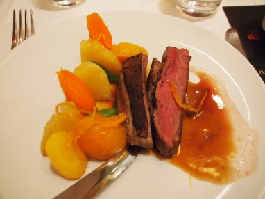 Duck breast with orange jus and seasonal vegetables