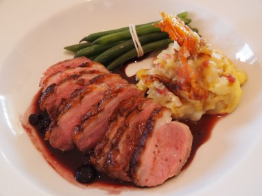 Duck breast with blueberry sauce and tartiflette potatoes
