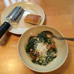 The finishing touch, grated Parmesan cheese atop the broccoli rabe soup.