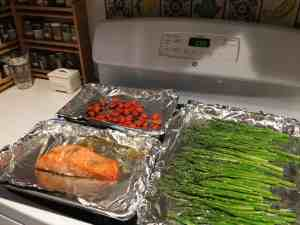 Roasted salmon, asparagus and grape tomatoes.