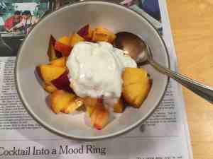Diced peach with yogurt.