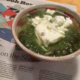 A bowl of Shav Soup, garnished with chopped dill, yogurt, and Bulgarian Feta Cheese.