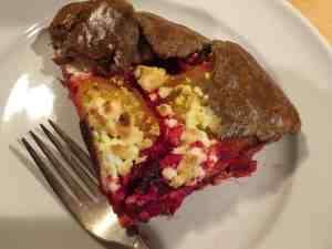 A slice of a savory galette, roasted beet with ricotta.