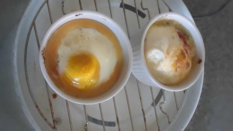 Finished baked eggs and spinach