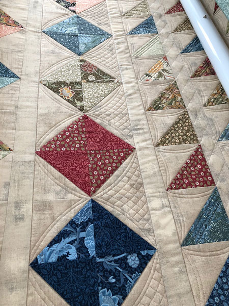 Curved Crosshatch quilting on Half Square Triangle quilt